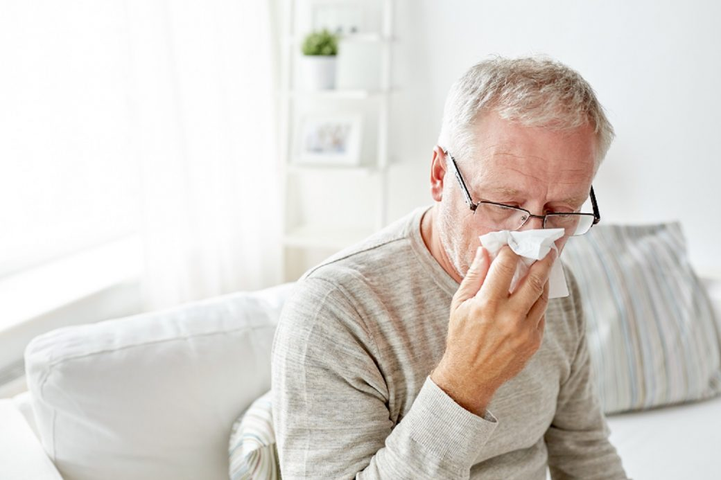 old man having a cold or influenza